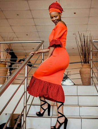 African Bride In Burnt Orange Dress With Shweshwe Print Detail