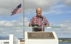 In this file photo, retired Master Chief Yeoman Jim Taylor, Pearl Harbor survivor liaison, speaks about Pearl Harbor survivor Coxswain Gale D. Mohlenbrink during an ash scattering ceremony at the USS Utah Memorial on Ford Island in 2013. (U.S. Navy/MCSN Johans Chavarro)