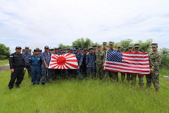 U.S. Navy and JMSDF explosive ordnance disposal technicians pose for a photo on Mount Suribachi during a tour, June 22, at the close of exercise IWOTO 2019. (JMSDF photo)