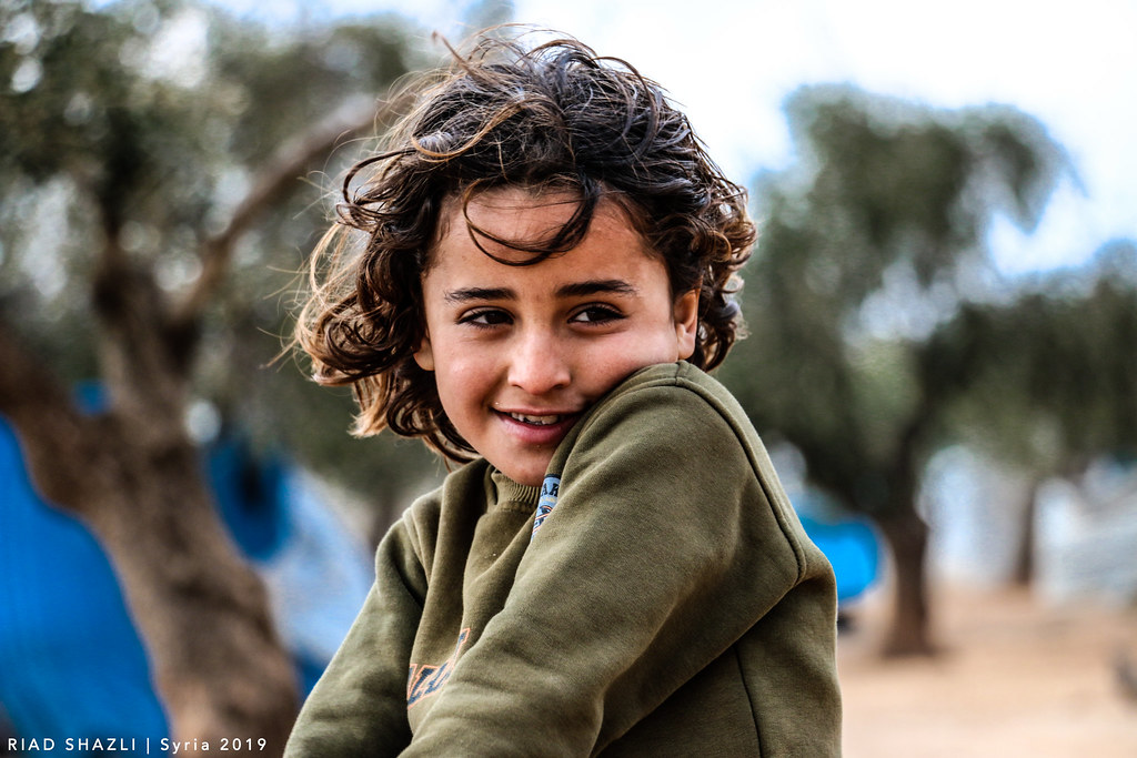 The eyes are confused ، and The beautiful smile . . . . . . . . Syria - Aleppo PH : Riad Shazli