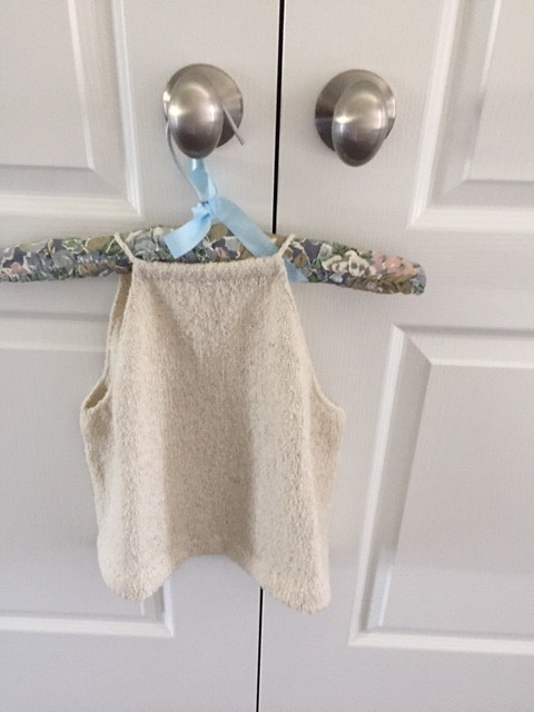 By Megan Nodecker from Knit Scene Magazine for my daughter. I used Berrocco Remix Light in Birch. It is hemmed using a picot edge and I-cord tie through casings in front and back!  By Rosemary Mulligan