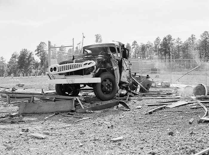 Front view of a truck damaged from an explosions.