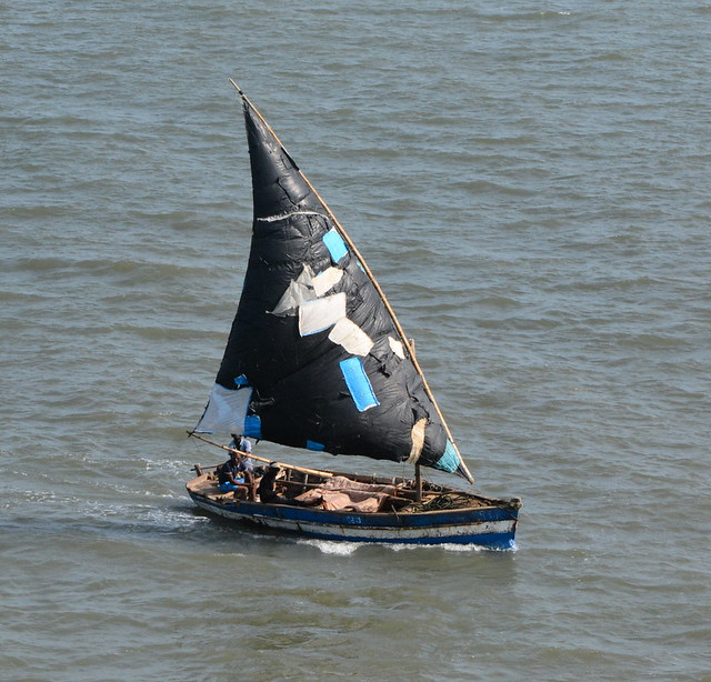MOZAMBIQUI,   MAPUTO,    SMALL FISHING BOAT AND  THE PATCHES WORK JUST FINE,  THANK YOU VERY MUCH!