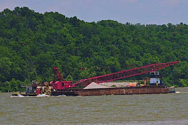 Crane moving down the Ohio River