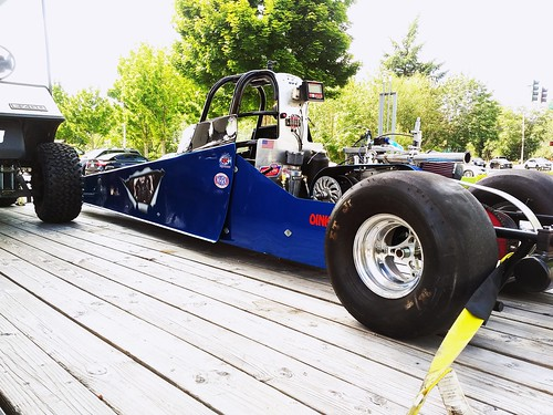 A dragster , a brave young man of seven is the driver of this little beast..