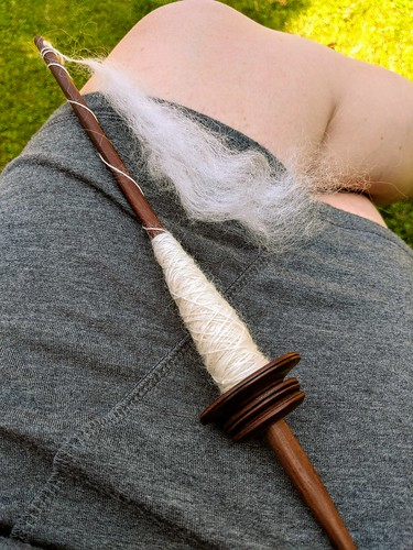 Spinning mohair top on Peruvian turned captive ring low-whorl drop spindle Pushka by irieknit