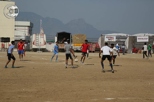 Devotees playing Football