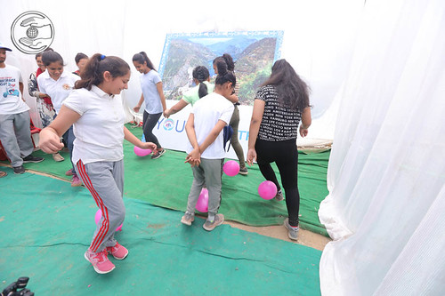Devotees playing the game
