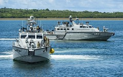 U.S. Navy Mark VI patrol boats approach the pier in Colonia, July 3. (U.S. Navy/MC2 Jasen Moreno-Garcia)