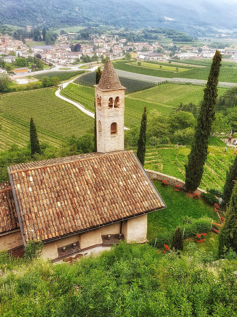 A small church overlooking a vineyard