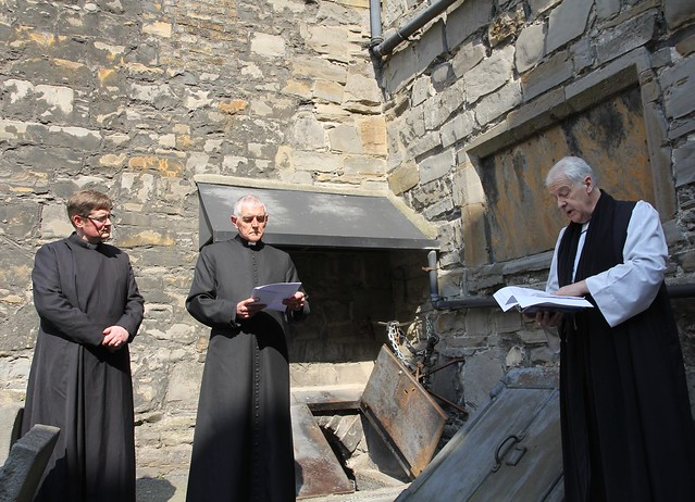 Prayers are said outside the crypt of St Michan's during its reconsecration. Pictured are the Revd Ross Styles, Archdeacon David Pierpont and Archbishop Michael Jackson.