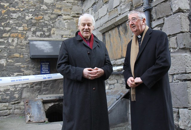 Archbishop Diarmuid Martin and Archbishop Michael Jackson at the entrance to the crypt of St Michan's Church.