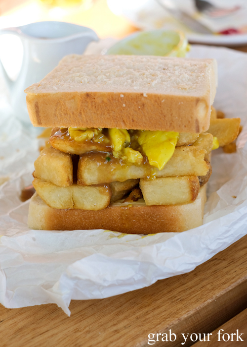 Hot chip butty with curried egg and dripping gravy at The Old Fitzroy Hotel in Woolloomooloo Sydney