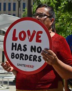 This menber of the union UNITE HERE was among the protesters who marched around Colorado Senator Cory Gardner's Denver office to object to the Trump administration's policies on immigration and refugees seeking asylum.