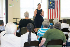 State Representative Stephanie Cummings answers questions during a legislative session wrap-up event at the Waterbury Senior Center.