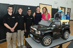 State Representative Stephanie Cummings recently joined Kaynor Technical High School students, including Nik Ballard, Robert Fanzutti and Adam Khan, faculty and administrators, including vice principal Dr. Tanya Celadon, to celebrate the donation of another group of customized, motorized vehicles for children with special needs.