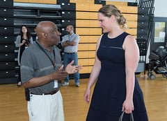 State Representative Stephanie Cummings speaks with Kaynor Technical High School principal Dr. Ken Hilliard, during the Go Baby Go! event at the school.