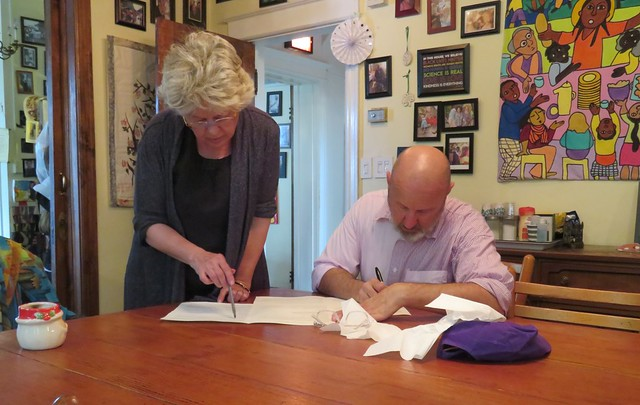 Photo of Patty Wudel and Scott Sanders working at an indoor table