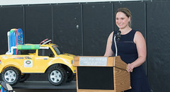 """State Representative Stephanie Cummings recently joined Kaynor Technical High School students, faculty and administrators to celebrate the donation of another group of customized, motorized vehicles for children with special needs.  The yellow Ford F150 or black GMC Sierra pickup trucks, which began as normal battery-powered toy cars for toddlers, have been adapted by Kaynor Technical students to match each child's individual medical needs and donated to the children as part of Kaynor's """"Go Baby Go"""" program. The students make sure car seats and medical equipment will fit, and each child's physical ability is factored into the design. Go Baby Go is a national, community-based research, design and outreach program that provides modified ride-on vehicles to special needs children from birth to age 3."""
