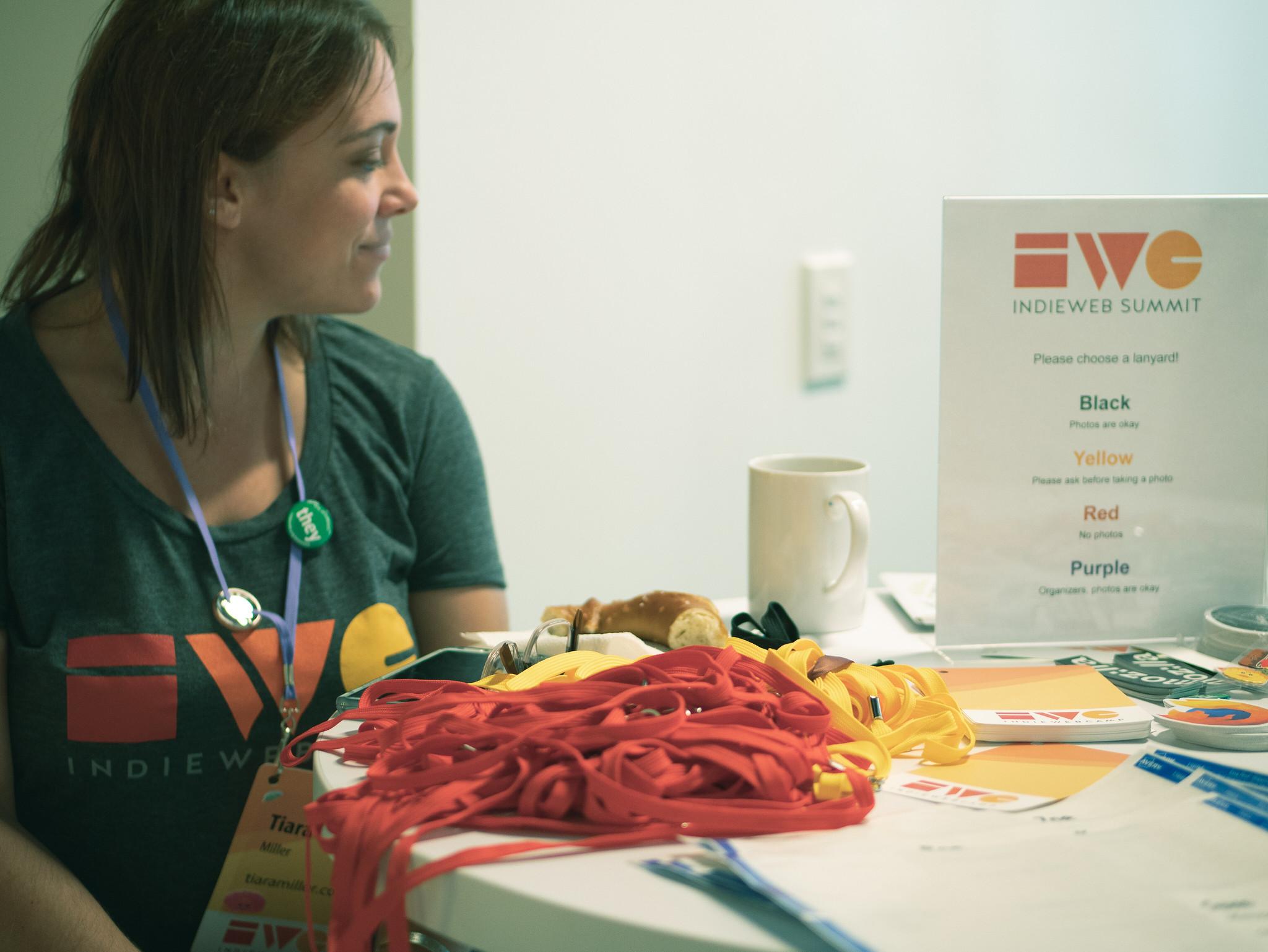 Tiara staffing the registration desk