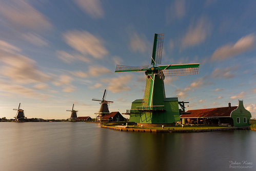 sunset zaanseschans zaandijk netherlands watercourse river dezaan windmills white clouds blue sky polder kalverpolder outdoor nikon d7500 water waterfront serene landscape skyline le longexposure mill travel tourist hotspot