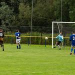 Calum Reid (partially hidden) heads in the seventh and final goal