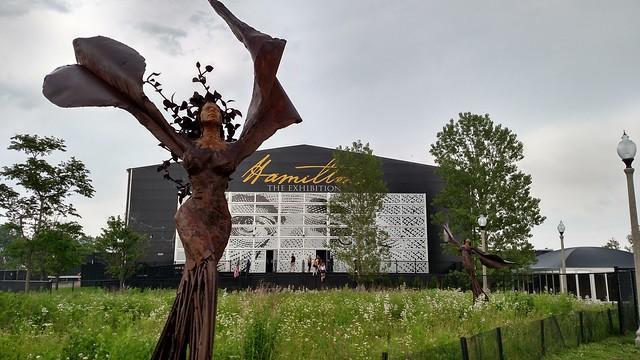 Picture of angel sculpture in front of the building for Hamilton: The Exhibition