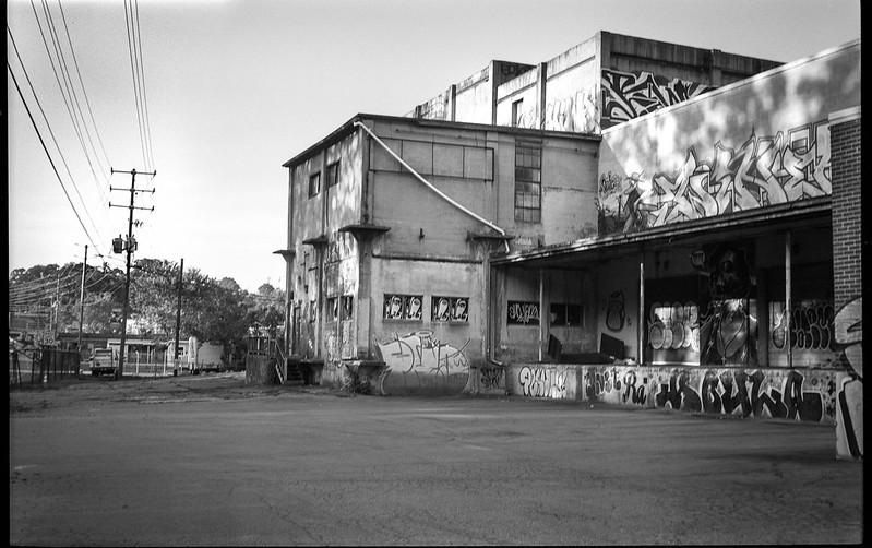 urban landscape, graffiti, speckled light, Asheville Waste Paper Mill, Asheville, NC, Ercona II, Kodak Tri-X 400, HC-110 developer, 6.28.19