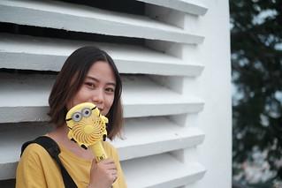 Little girl with Minion fan