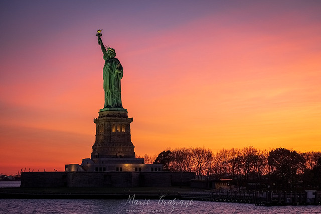 Lady Liberty over a warm sunset