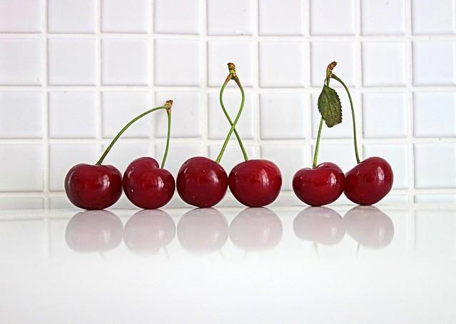three pairs of sour cherries