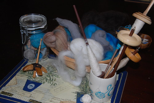 Jar with plying balls, basket with spinning fibre, cup with group of suspended spindles and Jenkins Turkish Delight for Tour de Fleece 2019 by irieknit