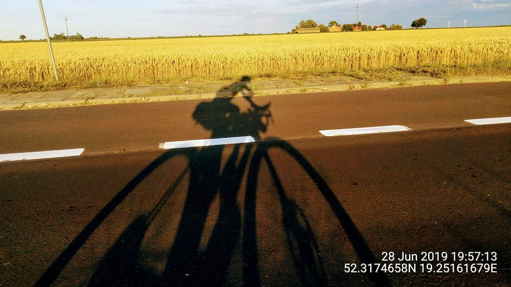 On the move through Europe. Bike silhouette against corn fields.