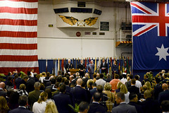Rear Adm. Karl Thomas, commander of the U.S. Navy's Task Force 70, speaks in the hangar bay aboard USS Ronald Reagan (CVN 76) during a reception celebrating the opening of exercise Talisman Saber, July 7. (U.S. Navy/MCSN Reina J. Delgado)