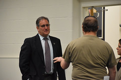 Rep. John Fusco talks with a constituent during a Town Hall meeting at the Southington Municipal Center.