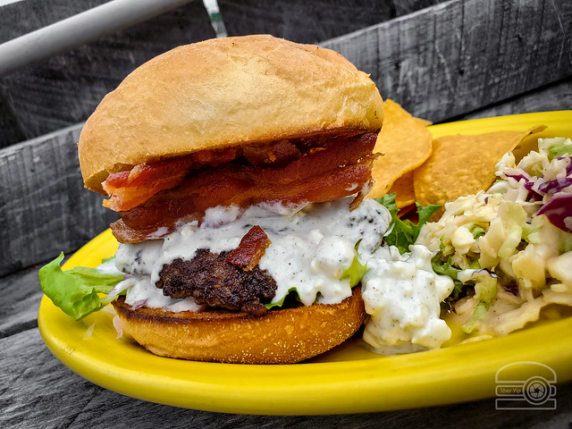 Red, white, and bleu burger w/ red onion, spicy tomato jam, Bleu cheese sauce w/ chunks of Bleu, and bacon - Black Bear Burritos Evansdale