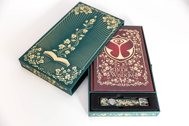 Ticket package for the Tomorrowland Festival 2019, with the Book of Wisdom and the Festival bracelet
