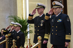 In this file photo, Adm. John Richardson salutes alongside Vice Adm. Shen Jinlong while arriving for a January meeting at the People's Liberation Army (Navy) headquarters in Beijing. (U.S. Navy/MCC Elliott Fabrizio)
