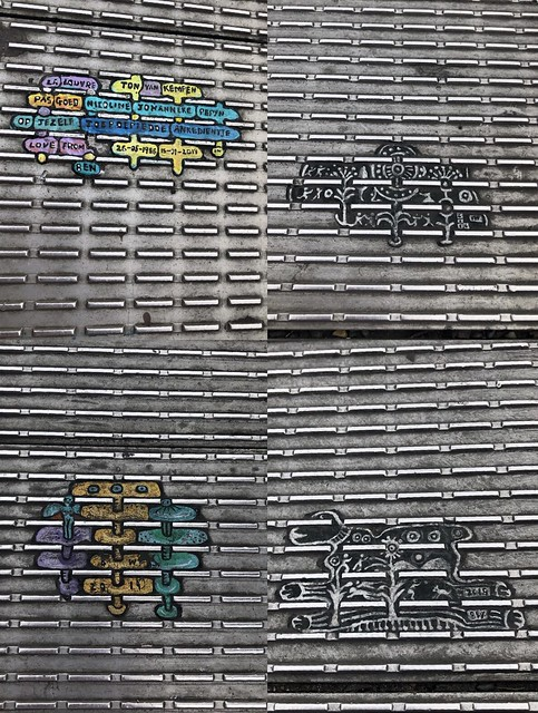 A collage of miniature paintings of shapes and words on the grates of a steel bridge.