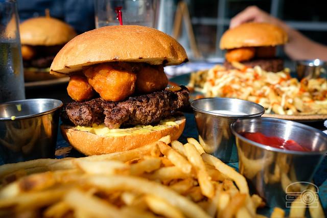 Burger w/  shallot marmalade, beer battered Gouda, mustard aioli - Table 9
