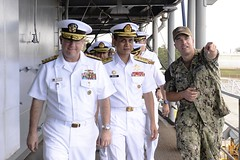 Capt. Jeff Bierley, commanding officer of the submarine tender USS Frank Cable (AS 40), guides Rear Adm. Jimmy Pitts and First Adm. Baharudin Bin Wan Md Nor on a ship tour, July 9. (U.S. Navy/MC3 Randall W. Ramaswamy)