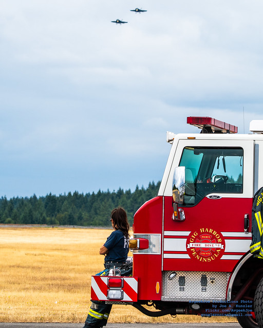 A GIG HARBOR FIREFIGHTER ENJOYING THE AIRSHOW