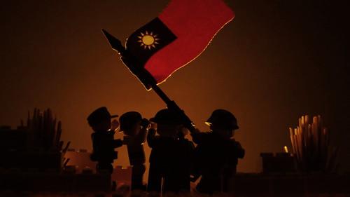 Flag Rising at Sunset
