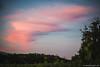 Le nuvole colorate dal tramonto passeggiando tra i vigneti della Franciacorta