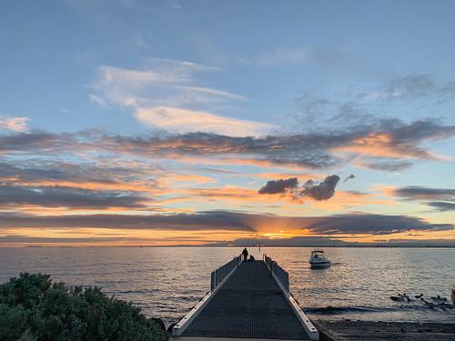 sunset melbourne brighton beach australia water clouds silhouette shadows portphillipbay winter coast shoreline people lastlight boat pier seascape he look