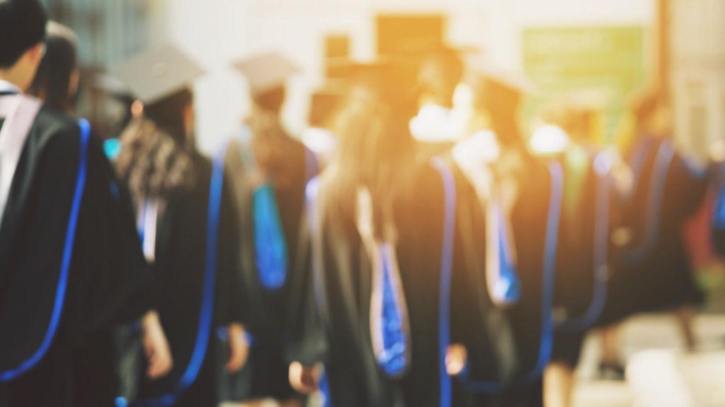 A blurred photo of graduating students.