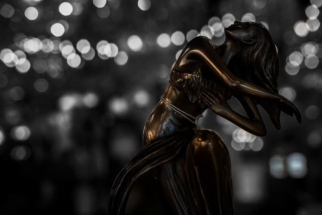 Faux Bronze Figurine in a Lamp Shop