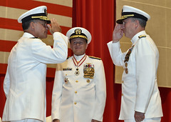 Rear Adm. Brian P. Fort, right, salutes Adm. John C. Aquilino, as he assumes command of Naval Forces Japan from Rear Adm. Gregory J. Fenton. (U.S. Navy/MC1 Aidan Campbell)