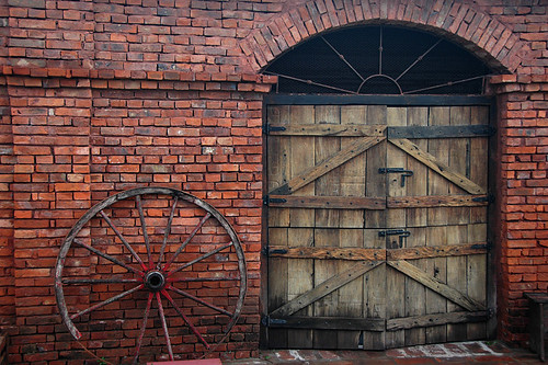 Brick wall and wood door of an estancia in the campo of Argentina