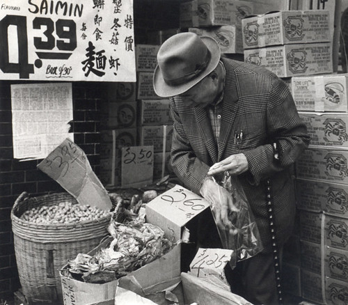 A man shopping in Vancouver's Chinatown circa 1974
